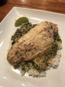 my first cooked blue apron meal of crispy catfish on the dinner plate