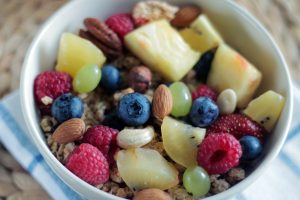 a bowl of fresh nuts and berries