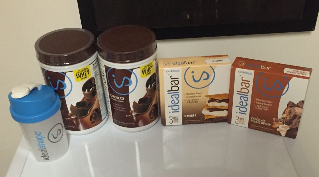 two bottles IdealShake and boxes of ideal bars on my kitchen counter
