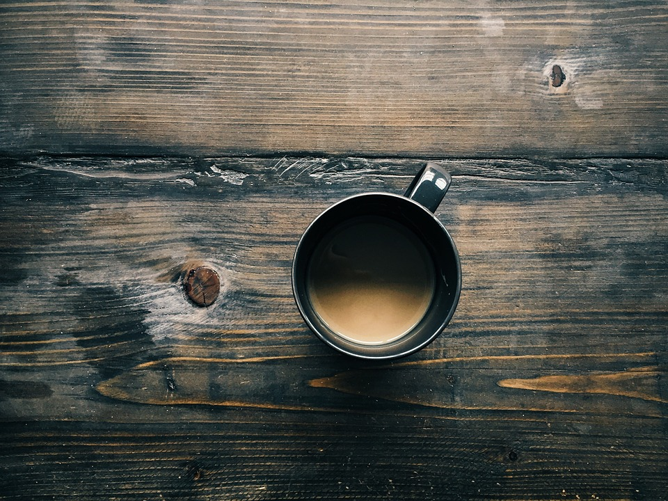 a cup of bulletproof coffee sits on the breakfast table