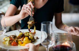 a woman eats a healthy meal