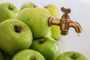 some green apples in a pile