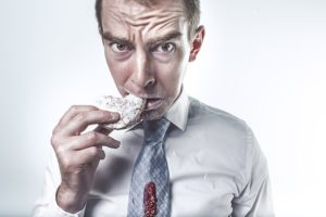 a guy eating after talking a long fast