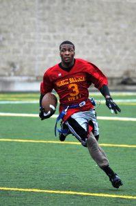 an athlete playing flag football runs back a kick return