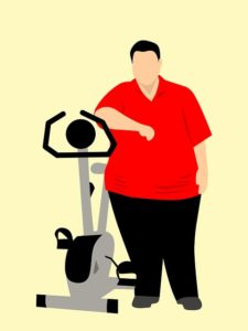 an obese man thinks about working out