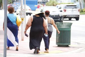 some obese women walking down the street