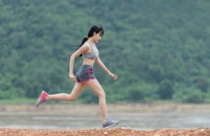 a woman runs to help improve the appearance of her thighs and legs