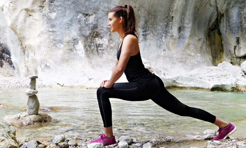 fit woman works out by a creek