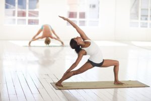 a woman does yoga while in ketosis