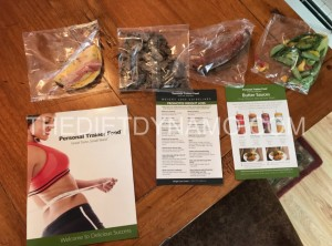 personal trainer food and welcome guide displayed on the table