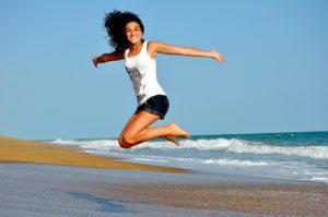 a woman jumps for joy because she's full of energy