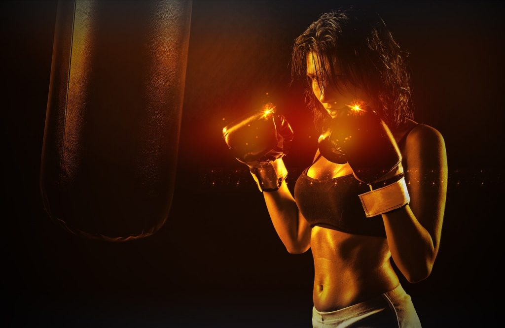 woman is doing a boxing workout and losing weight
