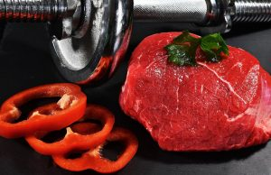 a big piece of meat, some veggies, and a dumbbell