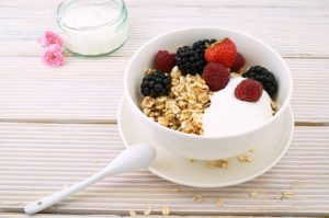a bowl of granola and berries
