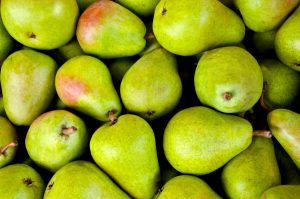a pile of green pears