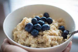 a bowl of oatmeal and blueberries