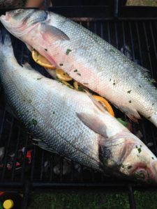 two seabass on the grill