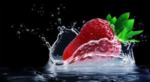 a strawberry falling in water