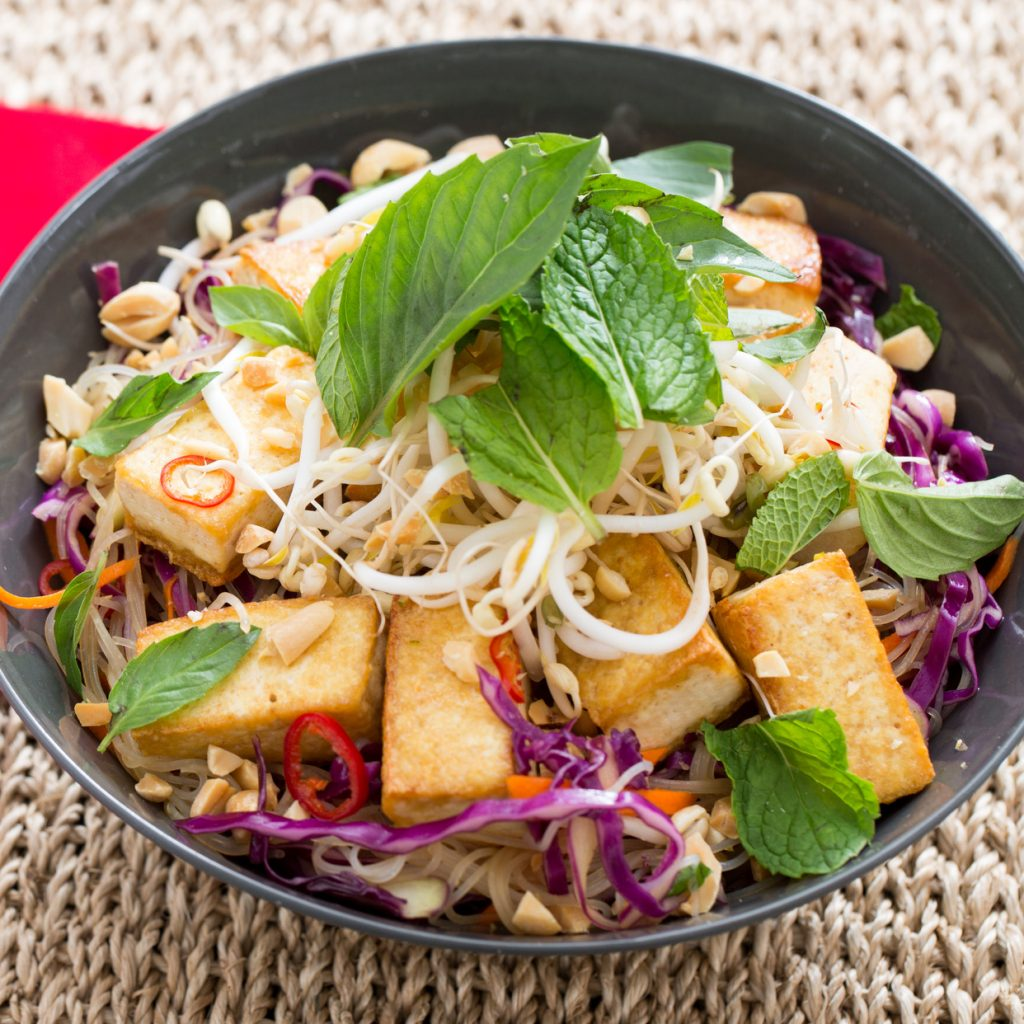 a blue apron vegetarian meal with tofu veggies and nuts