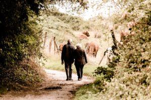 an elderly couple walks to the wine shop