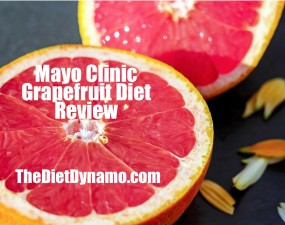 a grapefruit used in the mayo clinic diet is cut in half and laying on a table