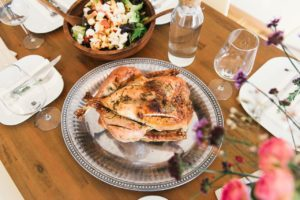 a roast chicken sits on the dining room table