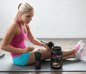 a woman blends together a ideallean diet shake after a tough workout
