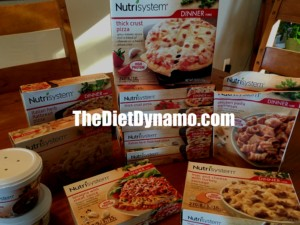 boxes of nutrisystem foods on the dinner table