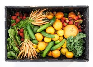 a box of healthy fruits and vegetables