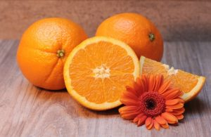 some oranges sitting on a table