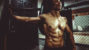 a man shows off his abs after working out
