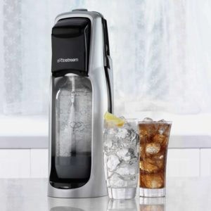 the sodastream jet sitting next to some drinks it made