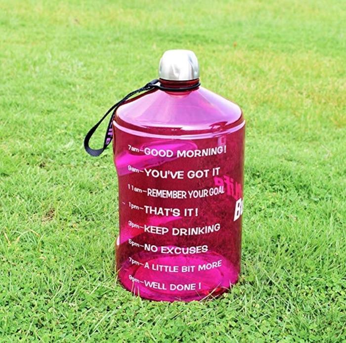 a water jug sitting in a field