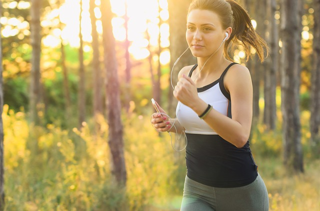 a woman burns calories while running